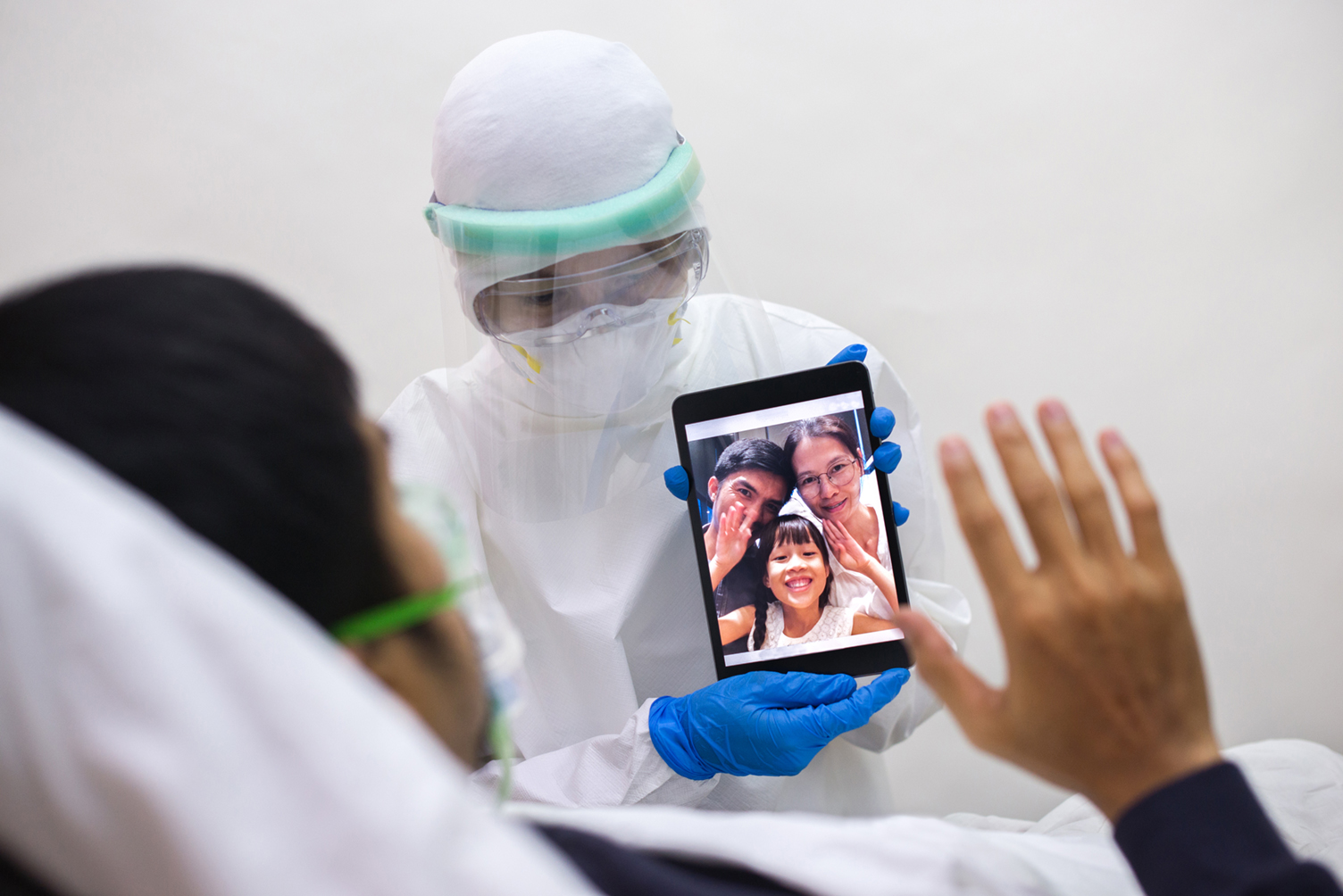 Nurse holding tablet with video call
